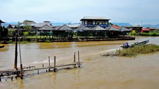 INLE LAKE, MYANMAR - FEBRUARY 18, 2018: Ywama fishing village with many tourist restaurants on stilts, floating canoes and handicraft workshops, on February 18 in Inle lake.