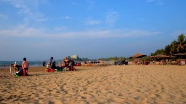 CHAUNG THA, MYANMAR - FEBRUARY 28, 2018: Relax on popular resort on the coast of Bay of Bengal, people enjoy picnics on the beach, swim and walk along the shore, on February 28 in Chaung Tha.