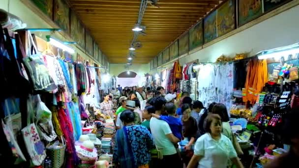 BAGAN, MYANMAR - FEBRUARY 24, 2018: The crowded covered tourist market next to Ananda Temple offers variety of local clothes, accessories, souvenirs and religious goods, on February 24 in Bagan.