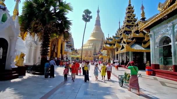 YANGON, MYANMAR - FEBRUARY 27, 2018: Visit magnificent Shwedagon Pagoda with huge golden stupa, richly decorated pavilions and masterpiece statues, sculptures and carvings, on February 27 in Yangon