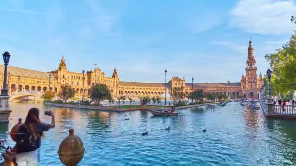 SEVILLE, SPAIN - OCTOBER 2, 2019: Timelapse of Andalusian style Plaza de Espana (Spain Square) with canal, full of boats, fountain and stinning architecture, on October 2 in Seville