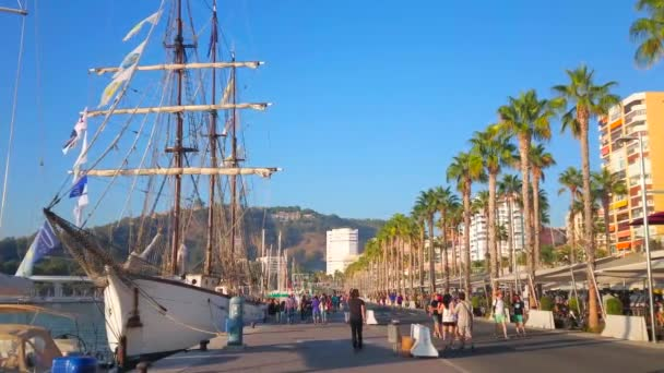 MALAGA, SPAIN - SEPTEMBER 28, 2019: Walk the scenic Muelle Uno pier and watch the sail ship and yachts in Malaga port, on September 28 in Malaga
