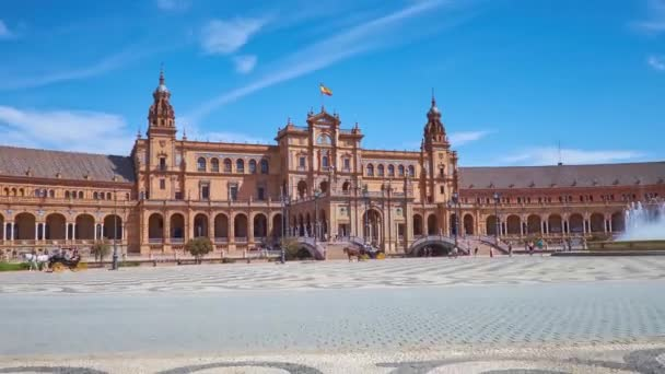 SEVILLE, SPAIN - OCTOBER 2, 2019: Panorama of Plaza de Espana (Spain Square), famous for its brilliant Andalusian style building, decorated with towers, arcade, tile pattern, on October 2 in Seville