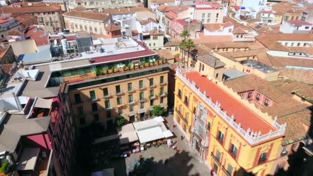 MALAGA, SPAIN - SEPTEMBER 26, 2019: Aerial view of Plaza Obispo square with street cafes, Baroque Bishops Palace (Palacio Episcopal) and roofs of historic mansions, on September 26 in Malaga