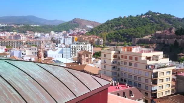 Amazing vista from Malaga Cathedral roof, located in heart of Old Town and overlooking city housing, Montes de Malaga (mountains), medieval Gibralfaro castle and Alcazaba fortress ruins, Spain