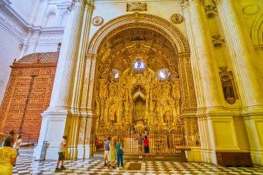 GRANADA, SPAIN - SEPTEMBER 25, 2019: The splendid gilt decors, sculptures and reliefs of Capilla de Nuestra Senora de Antigua of Incarnation Cathedral, on September 25 in Granada
