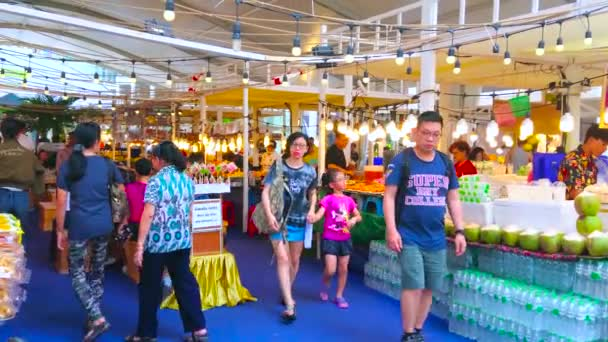 BANGKOK, THAILAND - APRIL 24, 2019: The crowded food fair pavilion at Central World shopping mall; the stalls offer Thai dishes, refreshing drinks, fresh fruits and snacks, on April 24 in Bangkok