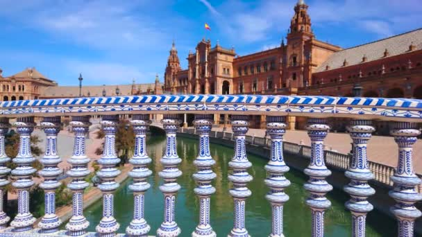SEVILLE, SPAIN - OCTOBER 1, 2019: The small bridge across the canal in Plaza de Espana with ceramic baluster, decorated with patterns in Andalusian Mudejar style, October 1 in Seville