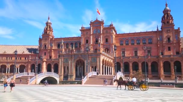 SEVILLE, SPAIN - OCTOBER 1, 2019: The large pedestrian Plaza de Espana with traditional medieval horse-drawn carriage transport, amusing tourists, on October 1 in Seville