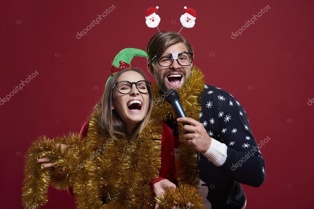 Having karaoke party during christmas time — Stock Photo ...
