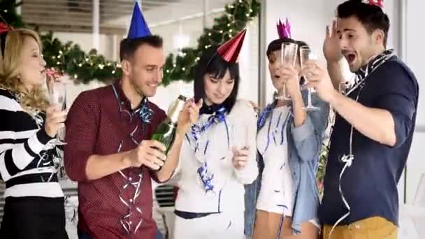 Group of young people toasting for achievements in New Year