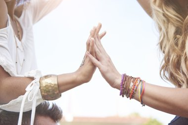 Two girls with bracelets on hands