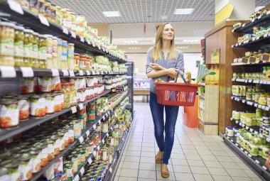 woman choosing proper products