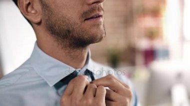 Bussinessman loosing his tie
