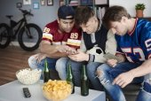 Photo Men checking out scoring system