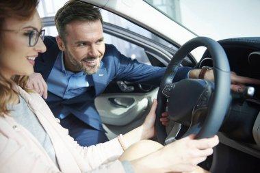 Couple buying new car