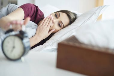 young woman waking up
