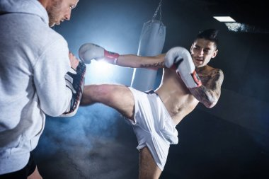 male boxer training with his coach