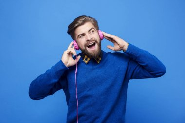Man listen to music by headphones and singing