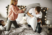 Cheerful couple during pillow fight