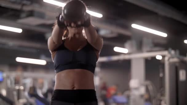 Athlete with a kettlebell exercising at gym