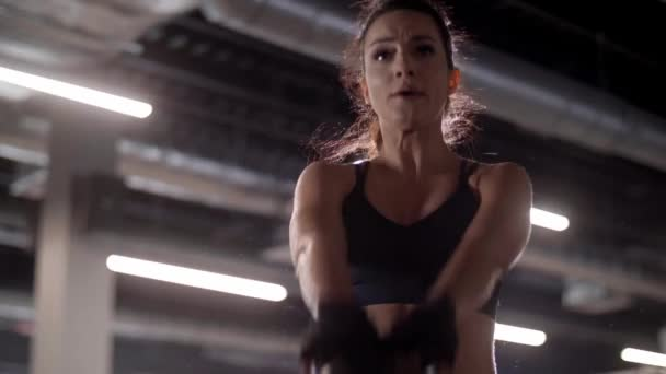 Woman using kettlebell at gym
