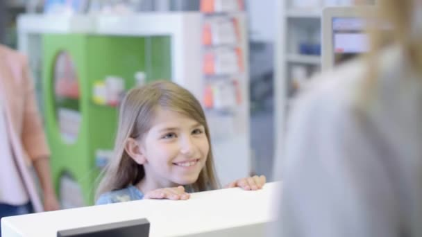 Pharmacist selling cough syrup at pharmacy