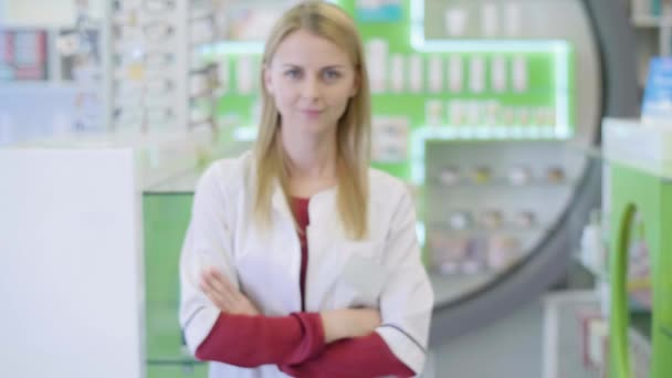 Beautiful pharmacist at a drugstore looking at the camera smiling