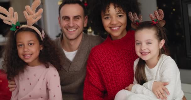 Handheld view of family spending Christmas together at home