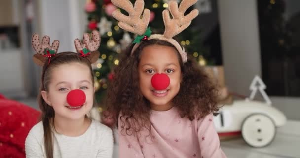 Handheld video shows of two little girls in Christmas costumes