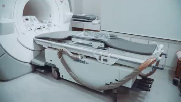 Room with white magnetic resonance tomograph for examination of the human body close-up