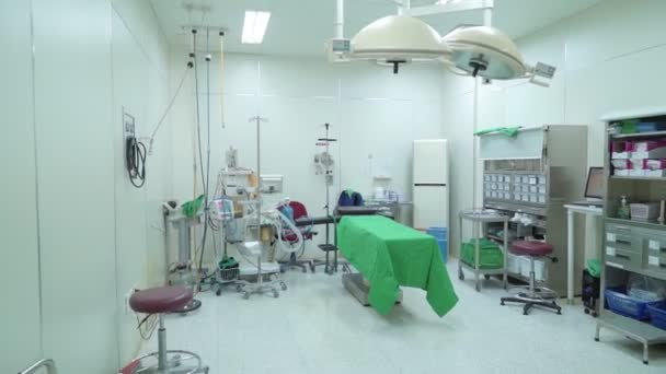 Equipped operating room without people with an operating table, light for surgical operations