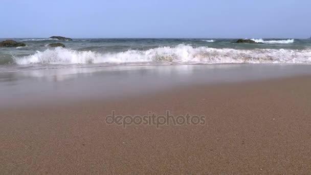 Surf on Sandy Beach. Slow Motion