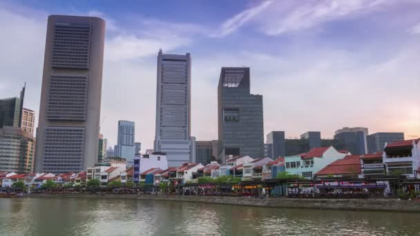 Evening Singapore. Chinese restaurants on the Boat Quay and skyscrapers. Time lapse