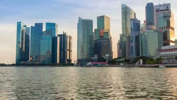 Singapore - October 17,2017: Marina Bay in Singapore. The Merlion fountain and skyscrapers. A lot of the tourists. Everning time lapse. Editorial Use Only