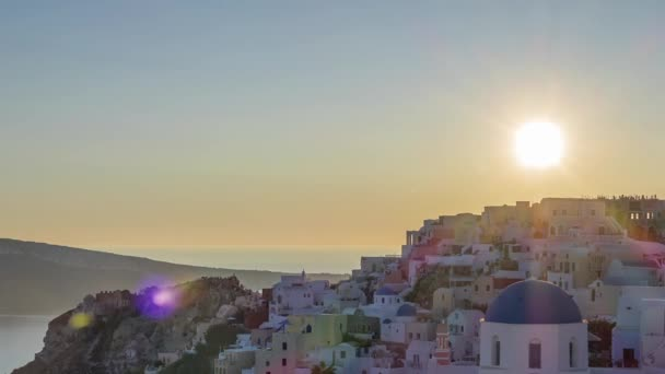 Greece. Thira Island. Roofs of Oia during a colorful sunset. Time lapse