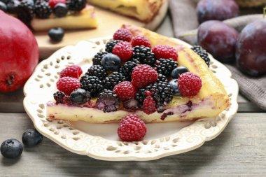 Piece of fruit tart with blackberries, raspberries and blueberri