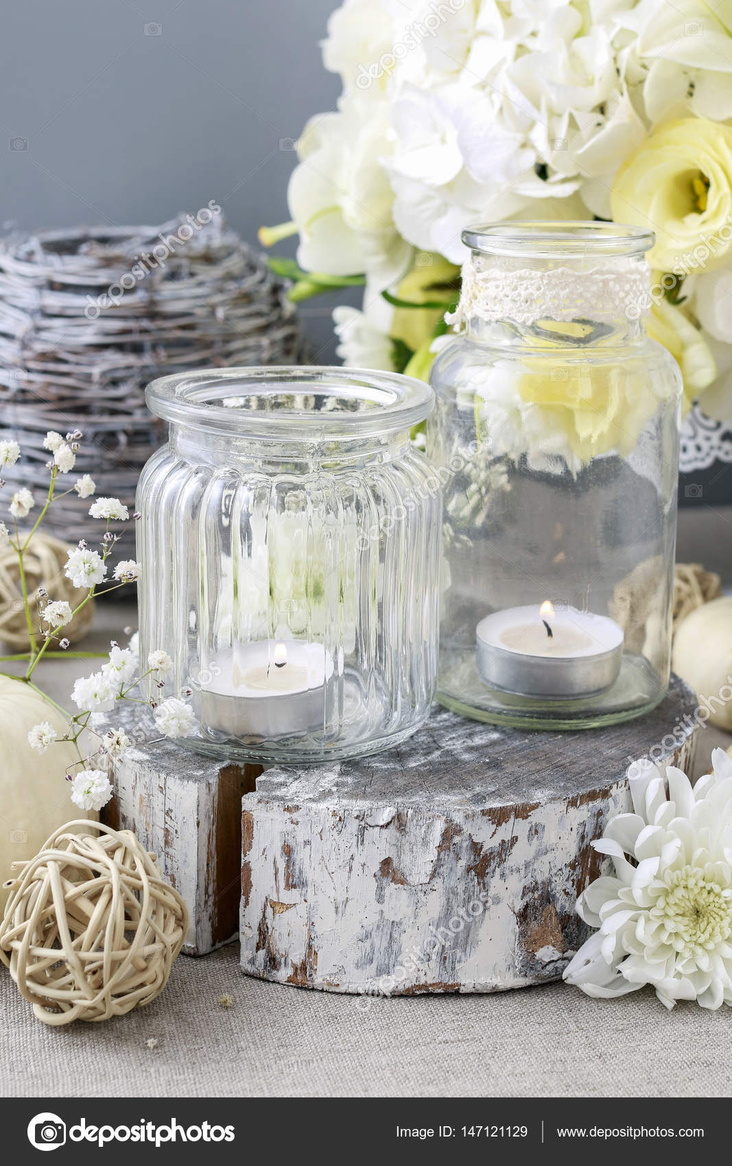 Wedding Decoration With Flowers And Candles In Glass Jars Stock