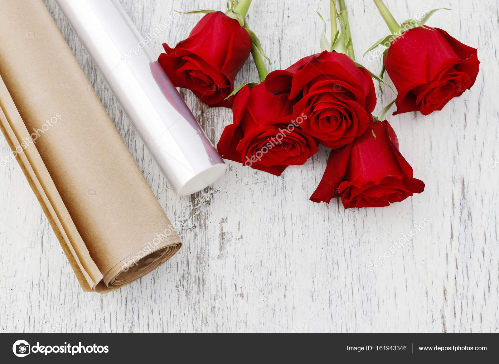 Paper or plastic stretch film as wrapping for red rose flowers paper or plastic stretch film as wrapping for red rose flowers stock photo mightylinksfo