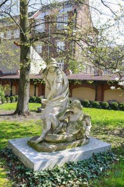 KRAKOW, POLAND - JULY 15, 2016: Sculpture in the garden of The Czapski Pavilion