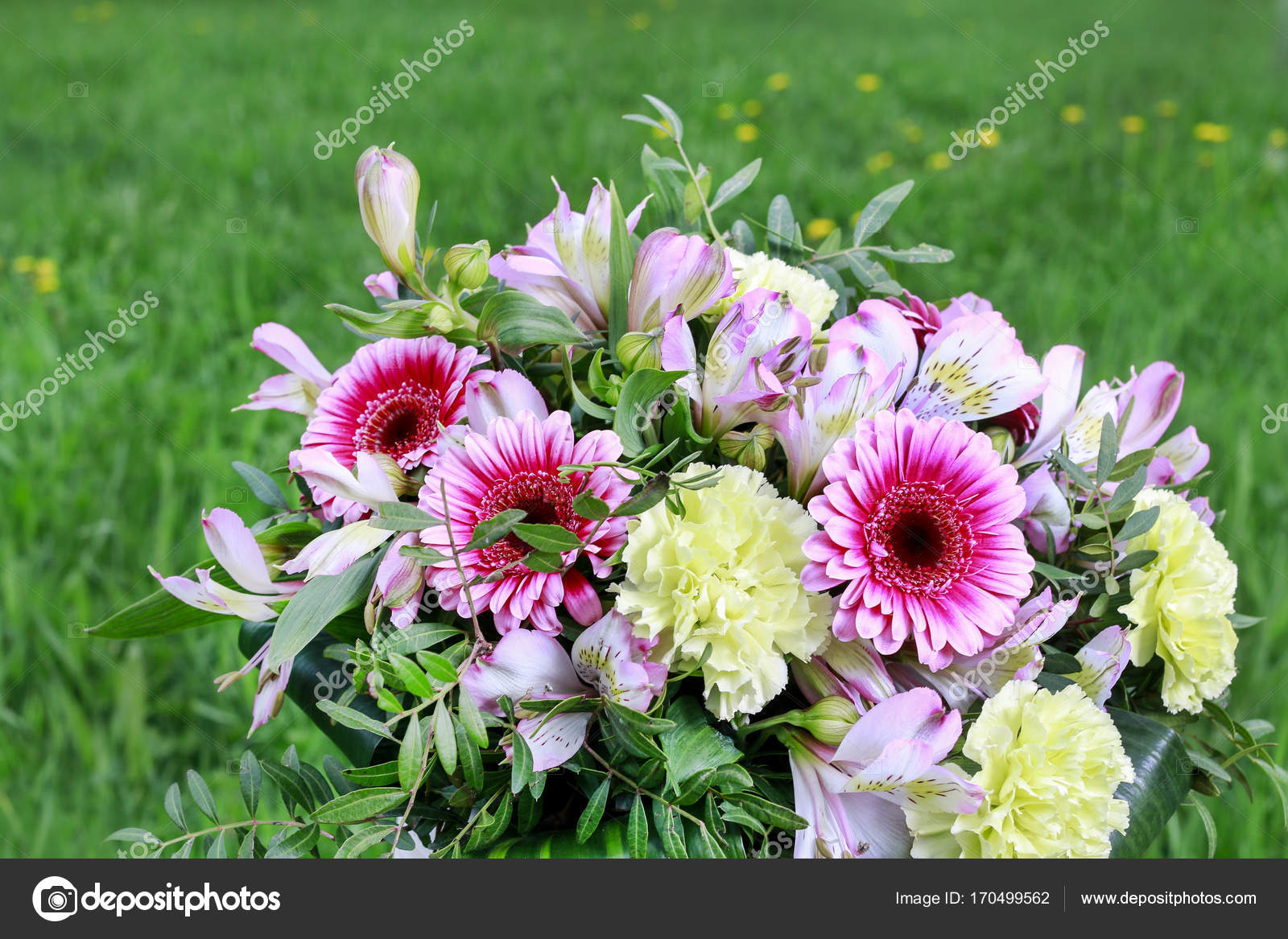 Big flower bouquet with carnations and gerberas stock photo big flower bouquet with carnations and gerberas grass in the background spring postcard photo by agneskantaruk izmirmasajfo