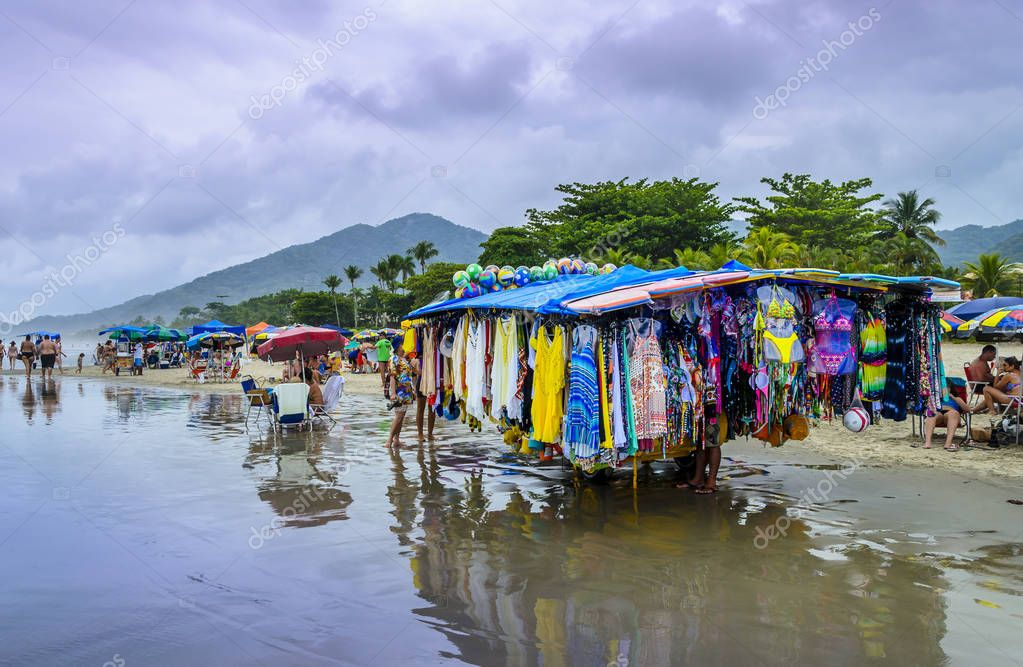 BRAZIL, JUQUEI  -DECEMBER 20th, 2017 ;  Seller on a rainy day on the beach in Juquei, Sao Paulo state, Brazil.