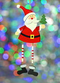 Vánoční dekorace, santa claus na bokeh barevné pozadí