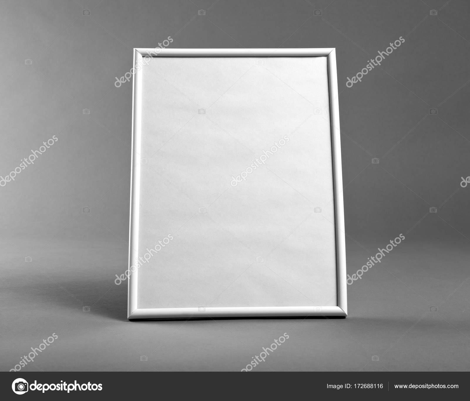 White vertical frame for paintings or photographs on gray backgr ...
