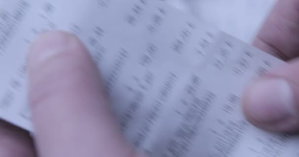 Finances during a COVID-19 crisis. Checking a long grocery receipt