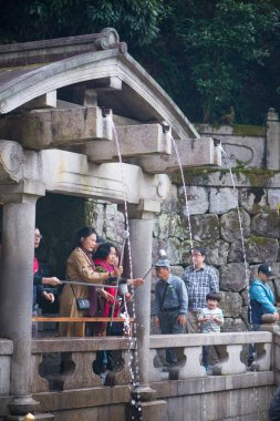 Kyoto, Japan - November 12, 2018:Tourist drink water from Otawa fall at Kiyomizu-dera Temple in Kyoto, Japan