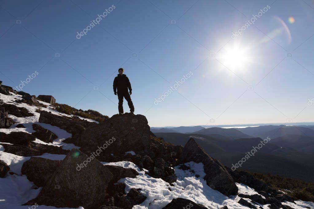Man Enjoying the Success of the Richardson Mountains