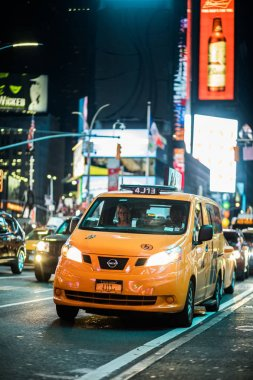 Traffic and Hybrid Cabs in Times Square at Night