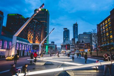 Montreal, Canada - December 3, 2017: Place Des Arts Square are Night with Kids and Parents having Fun on Seesaws that Change Light Intensity and also Makes Music.