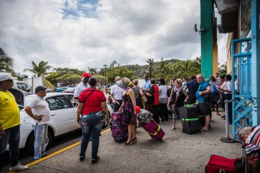 SAN ANDRES ISLAND, Colombia - Circa March 2017: Colombian Taxi and Shuttles Drivers Waiting for a Batch of Tourists in front of Airport in San Andres